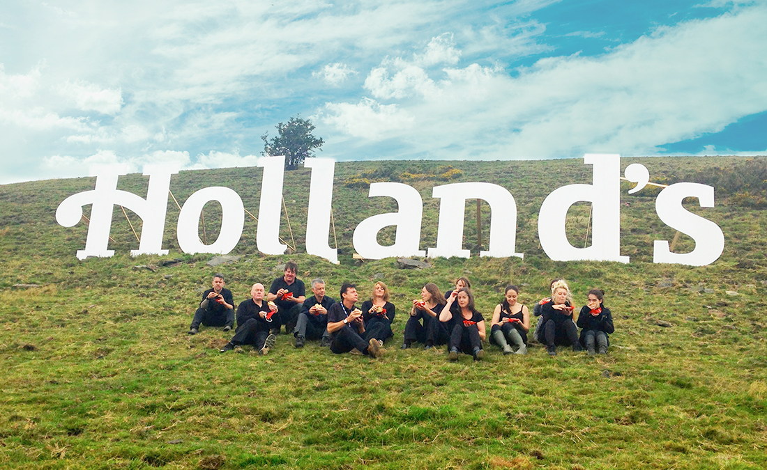 Hollands logo built on a hill in the style of the hollywood sign