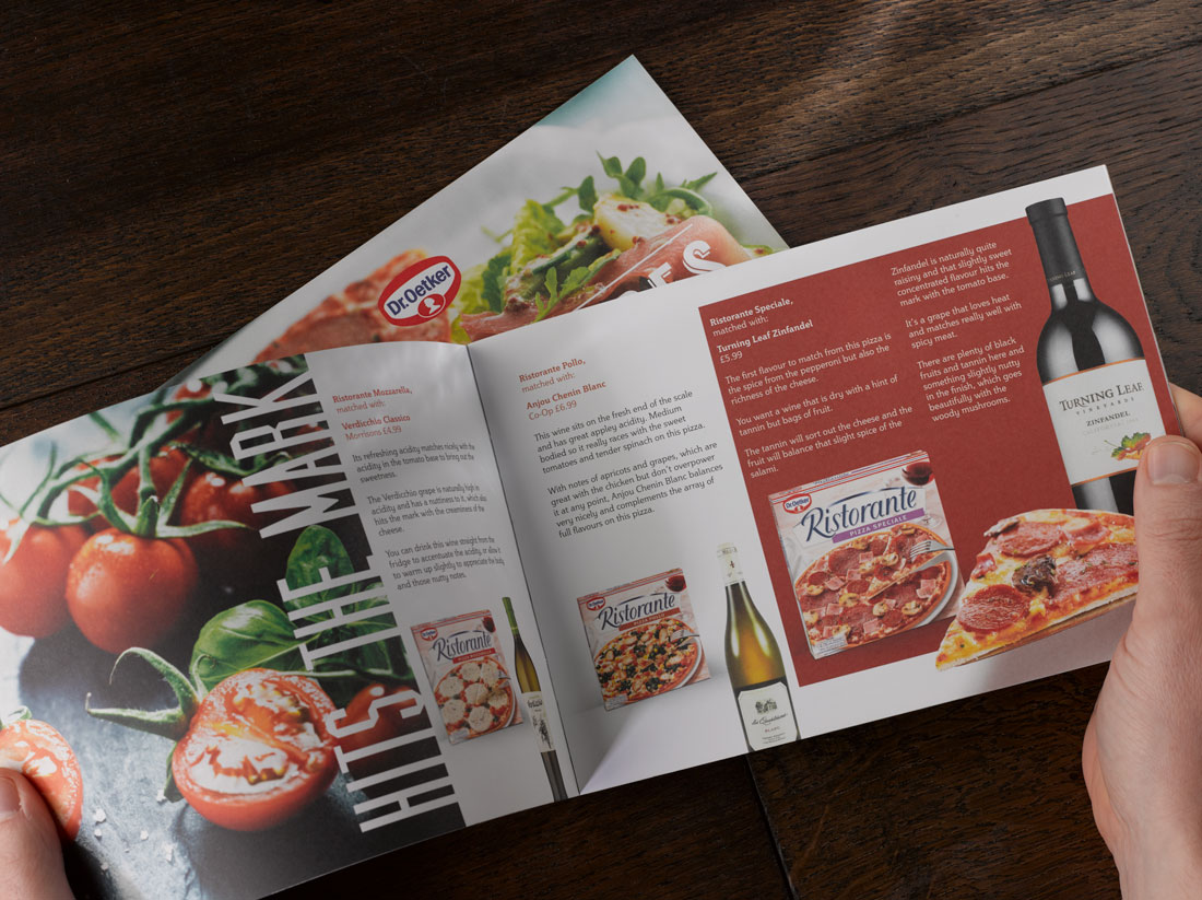 Dr Oetker Pizza and Wine guide photographed on dark wood