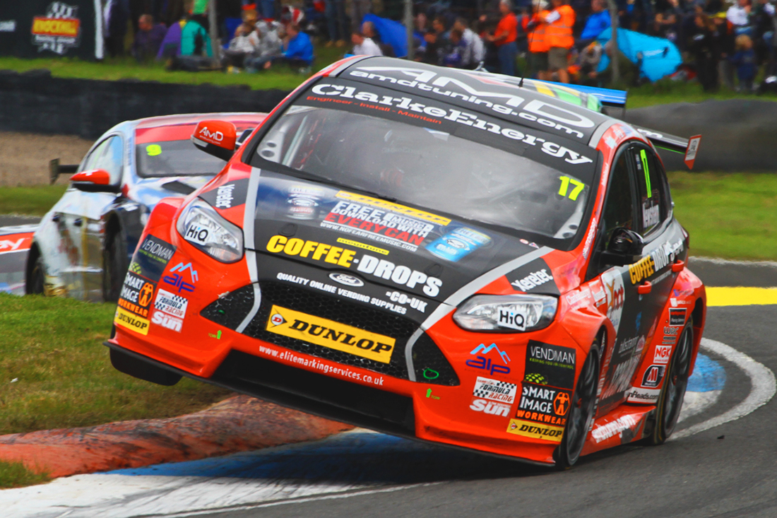 Dave Newsham BTCC racing car with No Fear bonnet graphics on Oulton Park